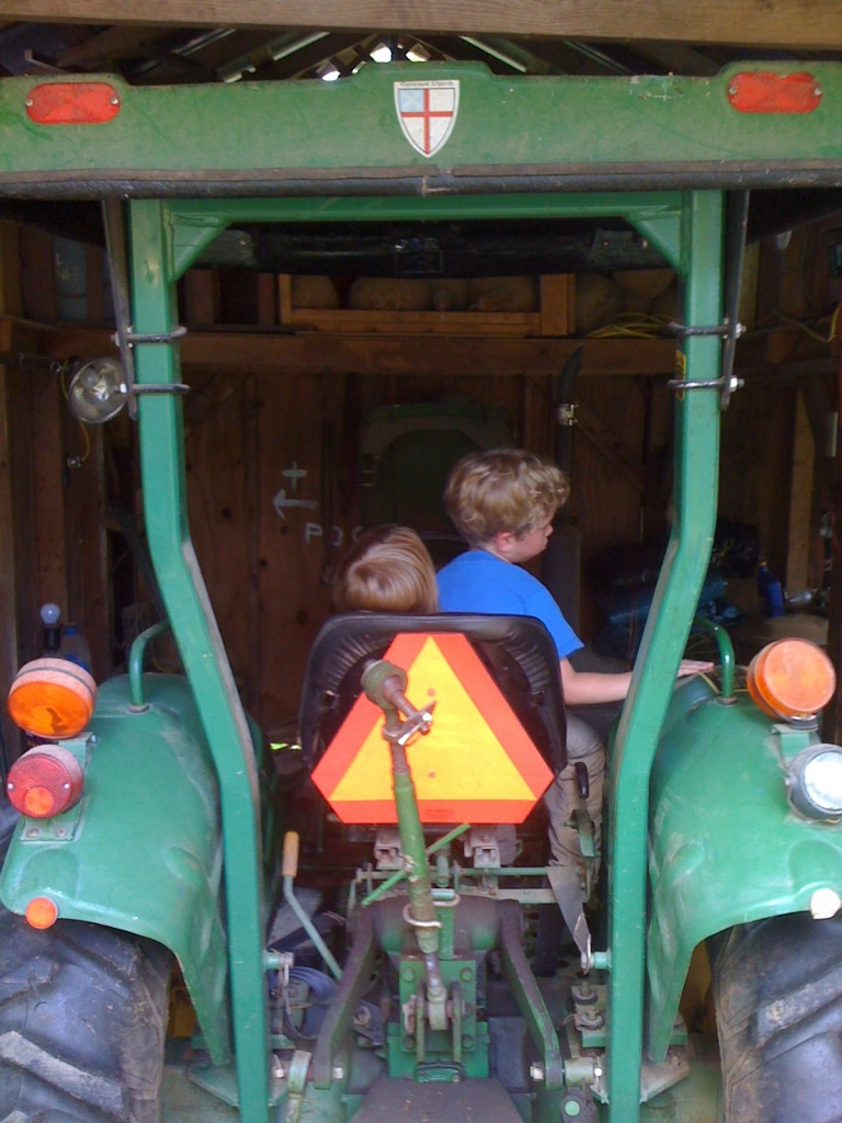 A true Episcopal farmer has the Episcopal shield on his tractor!