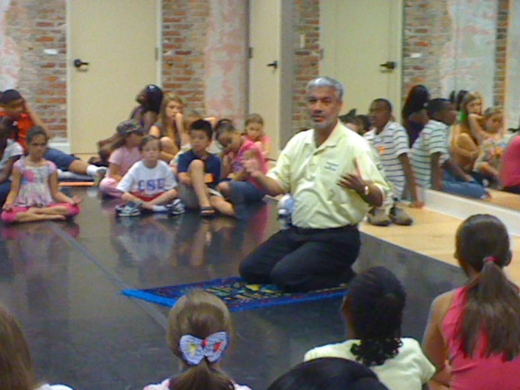 Ali teaches the children how Muslims pray.